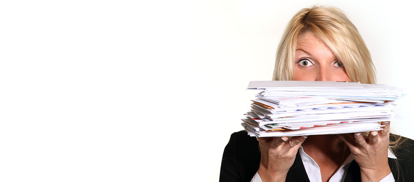 A person holding a stack of mail