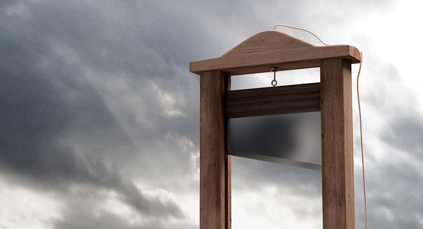 A guillotine against a cloudy sky