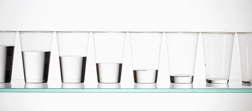 A row of glasses filled with different amounts of water