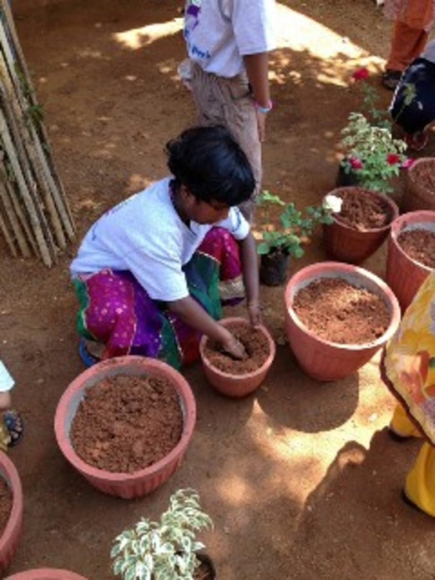 Children help plant flowers