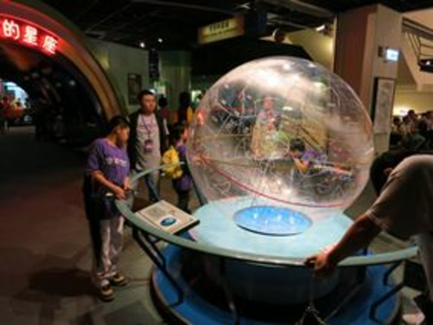 Synopsys volunteers guide children in exploring the interactive museum exhibits