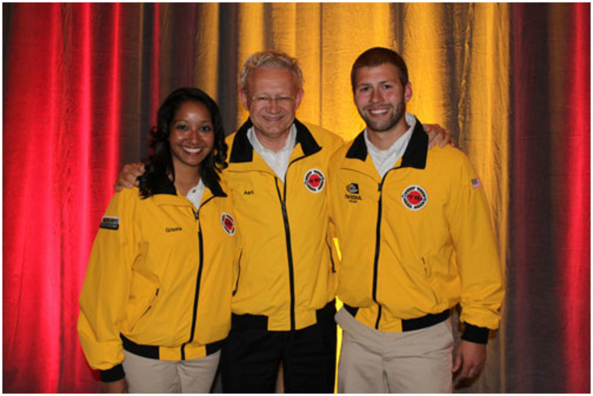Aart exchanged his suit jacket for a prestigious personalized City Year jacket, presented to him by two City Year corps members during the gala.