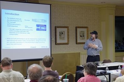 Dr. Thompson presenting an optical engineering talk at a recent CODE V User Group Meeting in Rochester, New York.